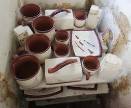 Shows how close pottery can be loaded on shelf when firing the kiln.